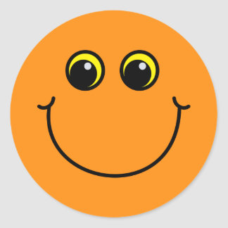 Visage souriant orange sticker rond