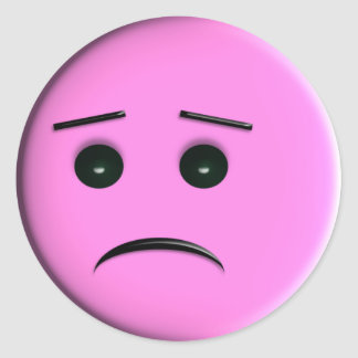 Visage souriant rose triste sticker rond