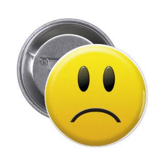 Visage souriant triste pin's