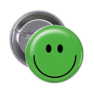 Visage souriant vert heureux pin's