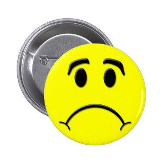Visage triste badge rond 5 cm
