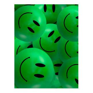 Visages souriants verts heureux frais d'amusement carte postale