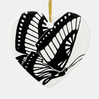 Vol de papillon dans le vent ornement cœur en céramique