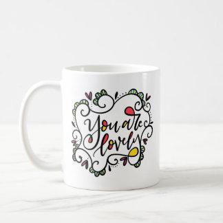 Vous êtes beaux, main marquée avec des lettres mug