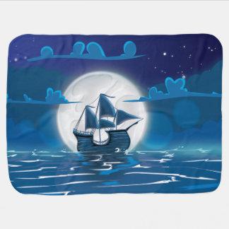 Voyage en bois de bateau de voile dans le clair de couvertures pour bébé