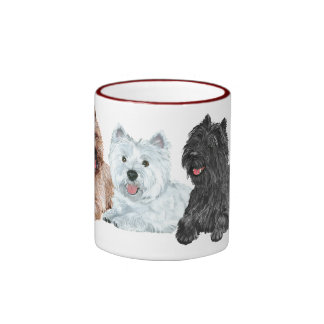 Westie avec deux terriers de cairn mug ringer