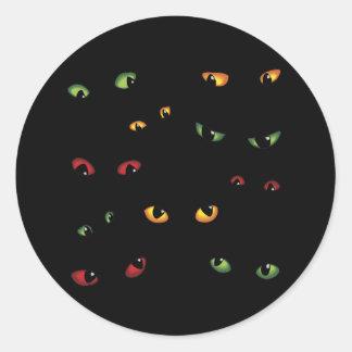 Yeux effrayants multicolores autocollants ronds