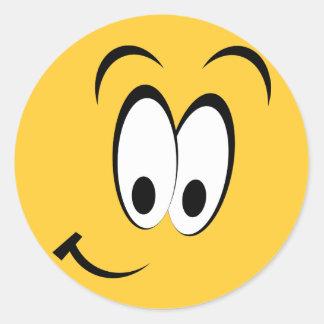 Yeux heureux et sourire autocollant rond