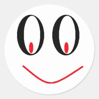 Yeux ivres de pays avec le sourire souriant d'un autocollant rond