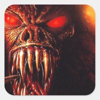 yeux rouges de monstre avec des crocs sticker carré