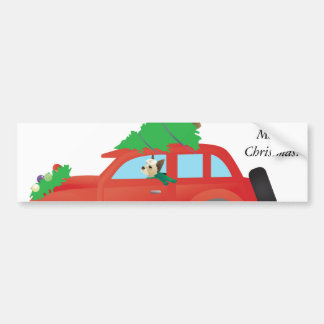 Yorkie conduisant une voiture de Noël avec un Autocollant De Voiture
